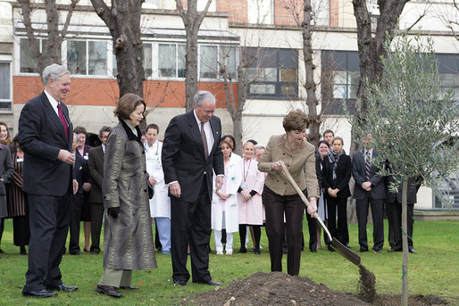 Mrs. Laura Bush plants an olive tree during her visit to the American Hospital of Paris Tuesday, Jan. 16, 2007, in Neuilly-on-Seine, France. Mrs. Bush is in France for a three-day visit to Paris. White House photo by Shealah Craighead