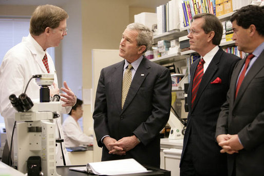 President George W. Bush listens to Dr. Marston Linehan, left, chief of Urological Oncology, as he tours a cancer lab at the National Institutes of Health in Bethesda, Md., Wednesday, Jan. 17, 2007. Also pictured are Health and Human Services Secretary Mike Leavitt, right, and NIH Director Dr. Elias Zerhouni, far right. White House photo by Eric Draper
