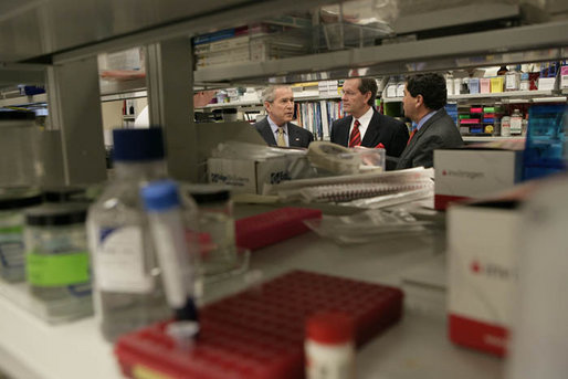 President George W. Bush participates in a tour of a cancer lab at the National Institutes of Health in Bethesda, Md., Wednesday, Jan. 17, 2007. Pictured with the President are Secretary Mike Leavitt, center, and NIH Director Dr. Elias Zerhouni, right. White House photo by Eric Draper