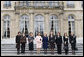 Mrs. Laura Bush stands outside Elysee Palace with other first lady attendees at the Conference on Missing and Exploited Children in Paris Wednesday, Jan. 17, 2007. The conference is hosted by Madame Bernadette Chirac, pictured in the center. White House photo by Shealah Craighead