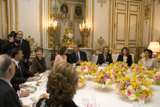 Mrs. Laura Bush attends a luncheon hosted by Madame Bernadette Chirac for the Conference on Missing and Exploited Children at the Elysee Palace in Paris Wednesday, Jan. 17, 2007. President Jacque Chirac of France is pictured in the center. White House photo by Shealah Craighead