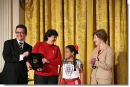 Mrs. Laura Bush presents Alicia Guadalupe Montero Perez, left, and Ingrid Janet Noh Canto, center, of La Chacara Children's Cultural Center a Coming Up Taller Award during a ceremony in the East Room Monday, Jan. 22, 2007. Gilberto Palmerin of the US-Mexico Foundation for Culture is pictured at the far left. Each year, the Coming Up Taller Awards recognize and reward excellence in community arts and humanities programs for underserved children and youth. White House photo by Shealah Craighead