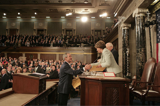 President George W. Bush greets Speaker of the House Nancy Pelosi before delivering his State of the Union Address at the U.S. Capitol Tuesday, Jan. 23, 2007. White House photo by Eric Draper