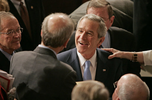 President George W. Bush greets people, shakes hands and signs his autograph after delivering the State of the Union Address in the House Chamber at the U.S. Capitol Tuesday, Jan. 23, 2007. White House photo by Paul Morse