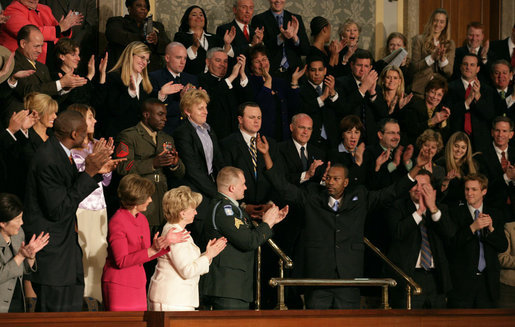 "Wesley Autrey receives a standing ovation as President Bush recognizes him during his State of the Union Address at the U.S. Capitol Tuesday evening, Jan. 23, 2007. ""Three weeks ago, Wesley Autrey was waiting at a Harlem subway station with his two little girls, when he saw a man fall into the path of a train,"" said President Bush. ""With seconds to act, Wesley jumped onto the tracks, pulled the man into the space between the rails, and held him as the train passed right above their heads. He insists he's not a hero. He says: 'We got guys and girls overseas dying for us to have our freedoms. We have got to show each other some love.' There is something wonderful about a country that produces a brave and humble man like Wesley Autrey."" White House photo by Shealah Craighead"