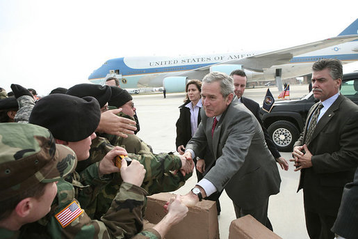 President George W. Bush greet National Guard personnel at New Castle Airport., Wednesday, Jan. 24, 2007. White House photo by Paul Morse