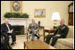 President George W. Bush and Vice President Dick Cheney meet with General Dan McNeil, incoming commander for NATO's International Security Assistance Force in Afghanistan, Wednesday, Jan. 24, 2007, in the Oval Office. White House photo by Eric Draper