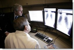 President George W. Bush visits with radiologist Dr. Jeffrey Kunin during a briefing on new x-ray technology at the Saint Luke's-Lee's Summit hospital in Lee's Summit, Mo., Thursday, Jan 25, 2007. President Bush also participated in a roundtable discussion on health care initiatives at the hospital. White House photo by Eric Draper