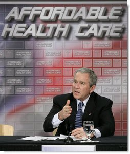 President George W. Bush gestures as he participates in a roundtable discussion on health care initiatives at the Saint Luke's-Lee's Summit hospital in Lee's Summit, Mo., Thursday, Jan 25, 2007. White House photo by Eric Draper