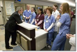 President George W. Bush visits with medical staff on his tour at the Saint Luke's-Lee's Summit hospital in Lee's Summit, Mo., Thursday, Jan 25, 2007. President Bush later participated in a roundtable discussion on health care initiatives. White House photo by Eric Draper