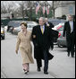 President George W. Bush and Laura Bush walk together as they leave the White House grounds Friday, Jan 26, 2007, to attend the farewell reception at Blair House for White House Counsel Harriet Miers. White House photo by Eric Draper