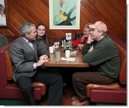 President George W. Bush visits with diner patron Bob Smith and family, Tuesday morning, Jan. 30, 2007, following a breakfast meeting with small business leaders at The Sterling Family Restaurant in Peoria, Ill., to talk about the economy.  White House photo by Paul Morse