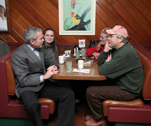President George W. Bush visits with diner patrons, Tuesday morning, Jan. 30, 2007, following a breakfast meeting with small business leaders at The Sterling Family Restaurant in Peoria, Ill., to talk about the economy. White House photo by Paul Morse