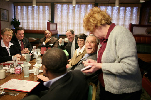 President George W. Bush speaks with a waitress taking his breakfast order Tuesday morning, Jan. 30, 2007, during a breakfast meeting with small business leaders at The Sterling Family Restaurant in Peoria, Ill. White House photo by Paul Morse