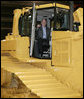President George W. Bush inspects the driver's compartment of a large Caterpillar bulldozer during a tour of the Caterpillar Inc. facility Tuesday, Jan. 30, 2007, in East Peoria, Ill., where President Bush addressed workers at the plant about the strength and growth of the U.S. economy. White House photo by Paul Morse