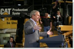 President George W. Bush gestures as he speaks to workers at Caterpillar Inc. in East Peoria, Ill., Tuesday, Jan. 30, 2007, on the strength of the U.S. economy.  White House photo by Paul Morse