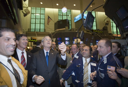 President George W. Bush tosses a baseball in the air as he greets traders Wednesday, Jan. 31, 2007, on the floor of the New York Stock Exchange. The unscheduled visit marked only the second visit by a sitting president during regular Exchange hours. White House photo by Paul Morse