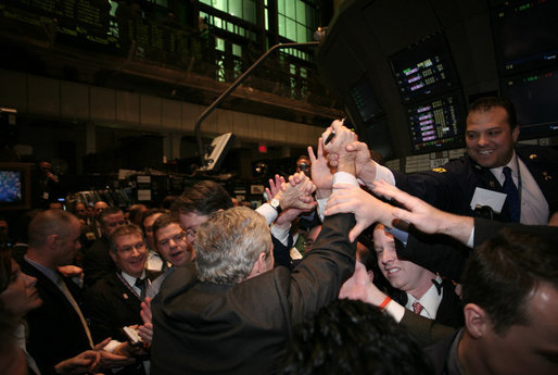 President George W. Bush is surrounded by traders on the floor of the New York Stock Exchange Wednesday, Jan. 31, 2007, during a surprise stop while on Wall Street to deliver remarks on the economy at Federal Hall. White House photo by Paul Morse