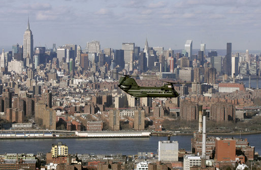The New York City skyline looms in the background as a helicopter carrying White House staff heads to John F. Kennedy International Airport Wednesday, Jan. 31, 2007. White House photo by Paul Morse
