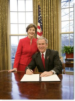 President George W. Bush is joined by Mrs. Laura Bush in the Oval Office at the White House, Thursday, Feb. 1, 2007, as President Bush prepares to sign the Presidential Proclamation in honor of American Heart Month. American Heart Month encourages Americans to take actions that reduce their risk and increase awareness of heart disease.  White House photo by Eric Draper