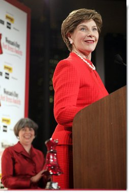 Mrs. Laura Bush accepts the Woman's Day Magazine Red Dress Award in New York, NY for her leadership in raising awareness of women's heart disease, February 1, 2007, as Jane Chestnutt, Editor in Chief of Woman's Day, looks on. White House photo by Shealah Craighead