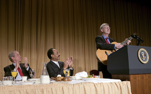 President George W. Bush and Representative Emanuel Cleaver, D-Mo., listen to Dr. Francis Collins during the National Prayer Breakfast in Washington, D.C., Thursday, Feb. 1, 2007. Dr. Collins is the director of the National Human Genome Research Institute. White House photo by Eric Draper
