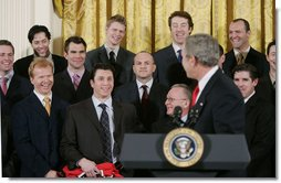 President George W. Bush jokes with members of the Carolina Hurricanes hockey team, winners of the 2006 Stanley Cup, Friday, Feb. 2, 2007 in the East Room at the White House.  White House photo by Paul Morse