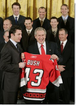 President George W. Bush receives a personalized team sweater from the Carolina Hurricane's team captain, Rod Brind'Amour, as the team was honored Friday, Feb. 2, 2007, at the White House for winning the 2006 Stanley Cup. White House photo by Paul Morse