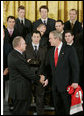 President George W. Bush shakes hands with Jim Rutherford, president and general manager of the Carolina Hurricanes hockey team, winners of the 2006 Stanley Cup, as Rutherford presents President Bush with a championship ring Friday, Feb. 2, 2007 in the East Room at the White House. White House photo by Paul Morse