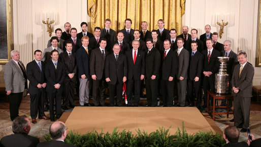 President George W. Bush poses for a photo Friday, Feb. 2, 2007, with the Carolina Hurricanes, winners of the 2006 Stanley Cup, in the East Room of the White House. White House photo by Paul Morse