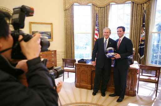 President George W. Bush and 2006 NASCAR Nextel Cup Champion Jimmie Johnson meet in the Oval Office, joined by members of the media, Monday, Feb. 5, 2007, in honor of Johnson's championship NASCAR season. White House photo by Eric Draper