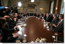 "President George W. Bush talks with the media during a Cabinet meeting in the Cabinet Room Monday, Feb. 5, 2007. ""I appreciate my Cabinet joining me today as we discussed our budget,"" said the President. ""Today we submit a budget to the United States Congress that shows we can balance the budget in five years without raising taxes.""  White House photo by David Bohrer"
