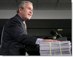 "President George W. Bush places his hand on a large stack of legislative earmarks as he addresses the employees at Micron Technology Virginia in Manassas, Va., Tuesday, Feb. 6, 2007, on the economy and fiscal responsibility. President Bush voiced his concern about earmarks being slipped into spending bills saying, ""If Congress is genuinely concerned about spending your money wisely, and I believe most members are, then, they must do something about earmarks."" White House photo by Paul Morse"