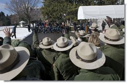 "Rangers from the National Park Service wave to President George W. Bush and Laura Bush as they depart for Shenandoah National Park where the President discusses his National Park Centennial Initiative. The Initiative provides for the potential of up to a $3 billion infusion of new funds over the next ten years on top of appropriations for normal operations. ""The funding starts with a billion-dollar request over the next 10 years that I'll send up to Congress,"" said President Bush of the largest ever increase for park operations. White House photo by Eric Draper"