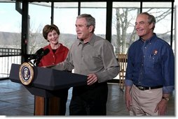 "President George W. Bush addresses the press during a visit to Shenandoah National Park in Luray, Va., with Mrs. Laura Bush and Interior Secretary Dirk Kempthorne Wednesday, Feb. 7, 2007. ""It is one thing to talk; it's another thing to act,"" said President Bush. ""And I've just submitted a budget to the United States Congress. In it we've got a billion dollars new money for operating expenses."" White House photo by Paul Morse"