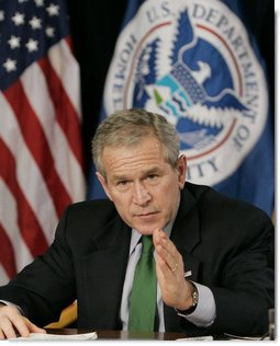 President George W. Bush gestures during a briefing Thursday, Feb. 8, 2007 at the Department of Homeland Security in Washington, D.C., on the status of DHS's priorities, especially those relating to the War on Terror. White House photo by Paul Morse