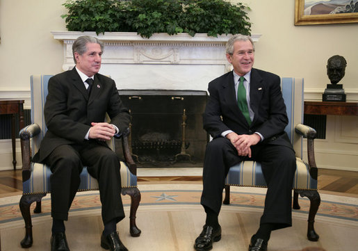 President George W. Bush and Amine Gemayel, former President of Lebanon, talk with reporters in the Oval Office Thursday, Feb. 8, 2007, during Gemayel's visit to the White House. White House photo by Paul Morse