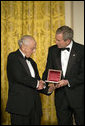 "President George W. Bush thanks David Herbert Donald for his scholarship in preserving the legacy of President Abraham Lincoln's life while at a dinner in honor of the Ford's Theatre Abraham Lincoln Bicentennial Celebration Sunday, Feb. 11, 2007, in the East Room. ""As we approach the bicentennial of President Lincoln's birth,"" said President Bush, ""his words and principles continue to guide our nation."" White House photo by Paul Morse"
