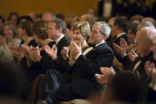 "President George W. Bush and Mrs. Laura Bush applaud singer Yolanda Adams in the East Room during a dinner held in honor of the Ford's Theatre Abraham Lincoln Bicentennial Celebration Sunday, Feb. 11, 2007. ""We are here tonight to remember the life -- the incredible life -- and the great sacrifice of the man who saved our Union,"" said President Bush. ""We remember Abraham Lincoln's eloquence, his wisdom, his unshakeable faith in the enduring truth that we're all created equal."" White House photo by Paul Morse"