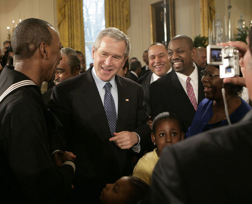 President George W. Bush meets with New York City subway hero Wesley Autrey, left, and members of the Autrey family, in the East Room of the White House, Monday, Feb. 12, 2007, during the celebration of African American History Month. White House photo by Eric Draper
