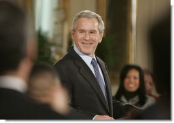 President George W. Bush welcomes guests to the East Room of the White House, Monday, Feb. 12, 2007, for the celebration of African American History Month. White House photo by Paul Morse