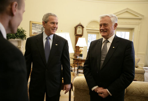 President George W. Bush is introduced to officials accompanying Lithuania's President Valdas Adamkus Monday, Feb. 12, 2007, during the leader's visit to the White House. White House photo by Eric Draper