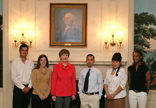 "Mrs. Laura Bush stands with the recipients of the 2007 Corps Member of the Year Award at the White House on Monday, Feb. 12, 2007. Pictured with Mrs. Bush from left, are recipients: Rosalio ""Leo"" Cardenas, 23, Alana Svensen, 26, Cop Lieu, 18, Yvette Chischillie, 23, and Tatiana Rodrigues, 19. As part of the Helping America's Youth Initiative, The Corp Network engages disadvantaged youth in education, career preparation and life skill development and honors youth who become involved in their communities, overcome adversity, and become role models for America's young people. White House photo by Shealah Craighead"