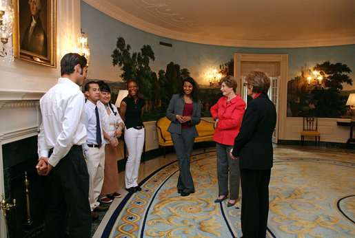 Mrs. Laura Bush talks with recipients of the 2007 Corps Member of the Year Award at the White House on Monday, Feb. 12, 2007. As part of the Helping America's Youth Initiative, The Corp Network engages disadvantaged youth in education, career preparation and life skill development and honors youth who become involved in their communities, overcome adversity, and become role models for America's young people. White House photo by Shealah Craighead