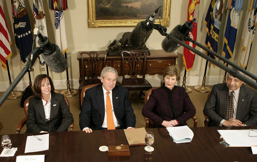 President George W. Bush, joined by Mrs. Laura Bush, talks with reporters during a briefing on volunteerism in the Roosevelt Room at the White House, Tuesday, Feb. 13, 2007, seen with Jean Case, chair of the President's Council on Service and Civic Participation, and Bob Goodwin, president and CEO of Points of the Light Foundation and Volunteer Center National Network. White House photo by Eric Draper