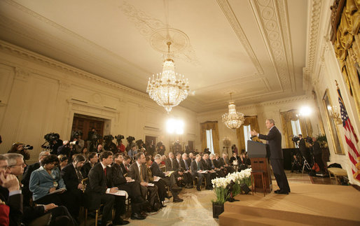 President George W. Bush delivers brief remarks before taking questions from the White House press pool Wednesday, Feb. 14, 2007, during a press conference in the East Room of the White House. White House photo by Eric Draper