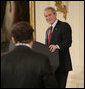 President George W. Bush smiles as he responds to a writer's question Wednesday, Feb. 14, 2007, during a press conference in the East Room of the White House. The President covered many topics including international issues and bipartisan opportunities. White House photo by Eric Draper