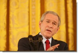 President George W. Bush emphasizes a point as he speaks to reporters Wednesday, Feb. 14, 2007, during a press conference in the East Room of the White House. The President spoke on Iraq, Iran and North Korea, as well as bipartisan opportunities, including education, energy, health care and a balanced budget.  White House photo by Shealah Craighead