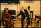 "President George W. Bush greets Liberia's President Ellen Johnson-Sirleaf during her visit Wednesday, Feb. 14, 2007, to the White House. President Bush applauded the leader's confidence and deep concern for the people of Liberia, saying, ""I thank you very much for setting such a good example for not only the people of Liberia, but for the people around the world, that new democracies have got the capability of doing the hard work necessary to rout out corruption, to improve the lives of the citizens with infrastructure projects that matter."" White House photo by Shealah Craighead"
