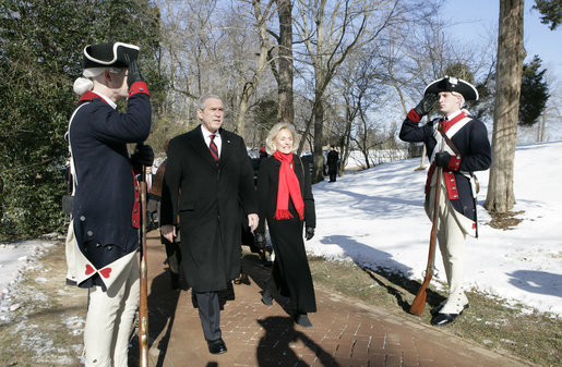 President George W. Bush is escorted by Gay Hart Gaines, Regent of the Mount Vernon Ladies Association, as President Bush and Mrs. Laura Bush arrive Monday, Feb. 19, 2007 to the Mount Vernon Estate in Mount Vernon, Va., to lay a wreath at the tomb of President George Washington in honor of Washington's 275th birthday. White House photo by Eric Draper